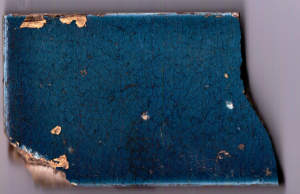 In the rubble behind the fireplace in No. 10, there were a number of peacock blue tiles.  They orignially would have been in a Victorian fireplace surround.