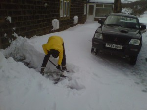 Digging out the snow drifts from the front door
