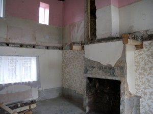 Downstairs in the lounge of number 10.  The fireplace has been taken out.  The floor beams that supported the floor upstairs have been removed.  You can see the ends of the beams (oak) to either side of the fireplace.