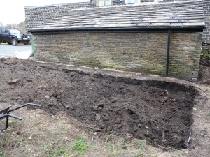 Another view of the ground all turned over and ready to be levelled. The back wall on the outbuilding is now starting to dry out since the gutter and the rainwater pipe have been installed.