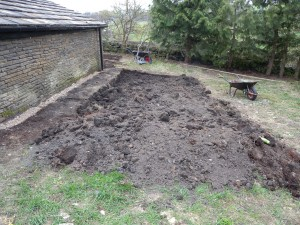 The ground is now dug over (removing any large stones and debris), but it needs to be levelled next.