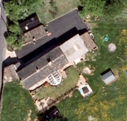 Satellite image from Google Earth.  Not sure when it was taken, but I suspect in 2009 sometime.  You can clearly see the conservatory (now removed) and a number of timeber sheds (also removed).