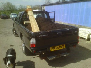 The L200 will carry about 1 ton on the back.  With a cubic meter of soil on the back, we are just about full!