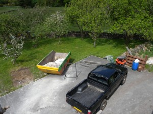 My pickup truck and a skip.  Question is which is which!