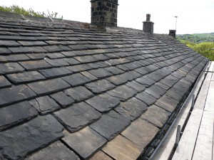 This is the front of the roof - all made from stone slates.  It has probably been re-roofed a number of times and this explains the varying qualtiy of the slates.  The slates are coursed so the bigger ones are at the bottom and the smaller ones are at the top.