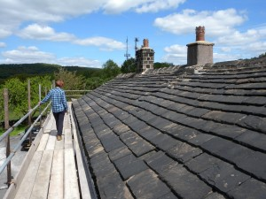 Jo admiring the traditional stone slate roof!