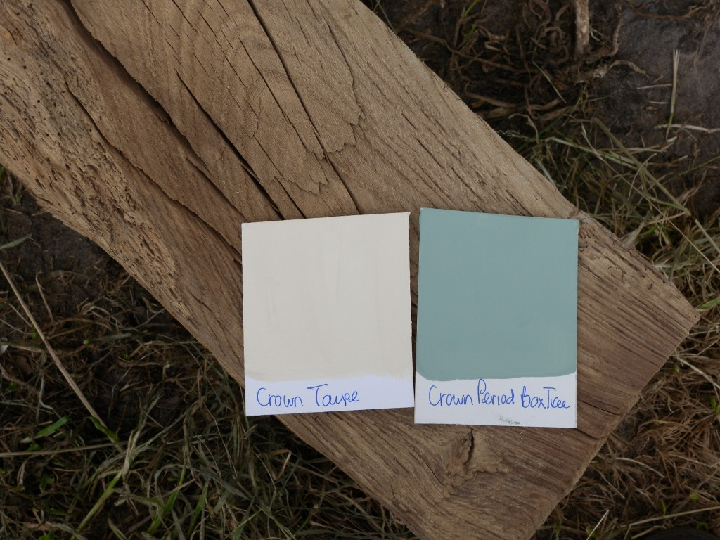 Two colour swatches on a piece of sandblasted oak beam.
