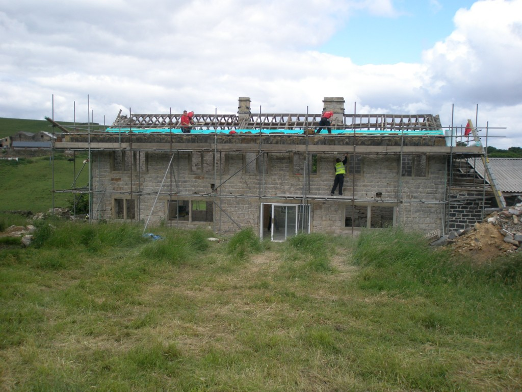 The two chimneys have been rebuilt and sandblasted.  So too has the rear of the property.  The felt and lathes are going on first to be followed by the stone slates.