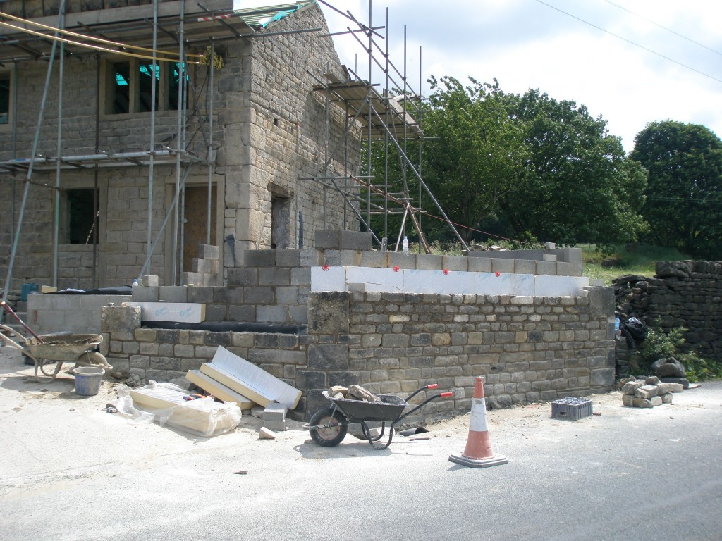 Concrete blockwork on the inside then 100mm insulation and finally the original gritstone on the outside.  Once it is finihsed, we will get it sandblasted to match the main property.