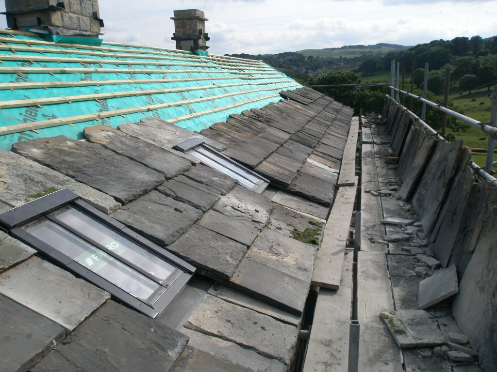 This is the view of the front of the roof with the two rooflights.  We are waiting for some lead before the slates can be fitted underneath each of the rooflights.