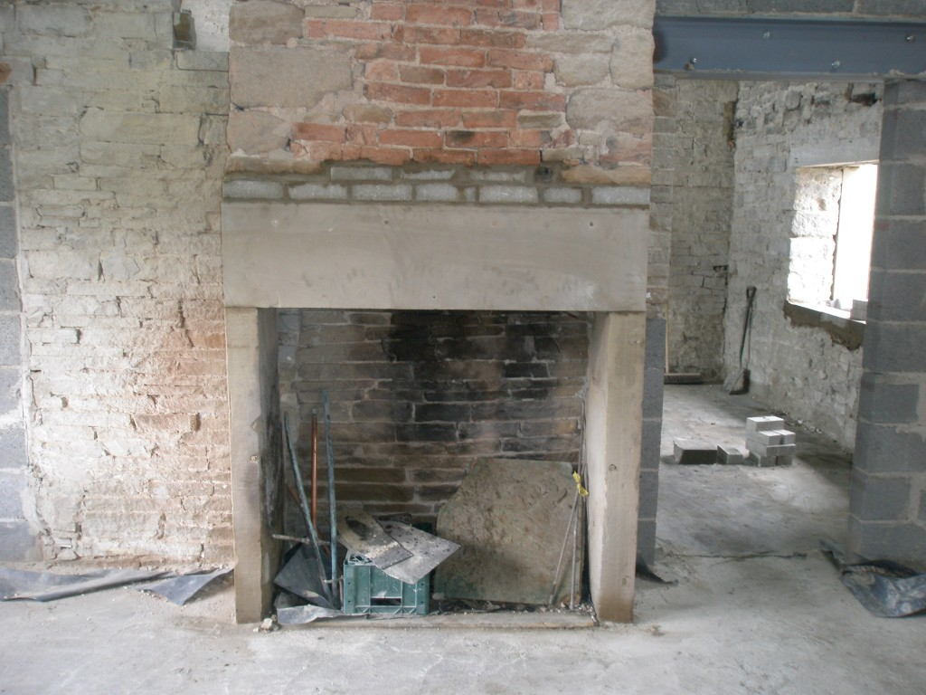 The stone mantel came from the Sycamore pub when it was refurbished.