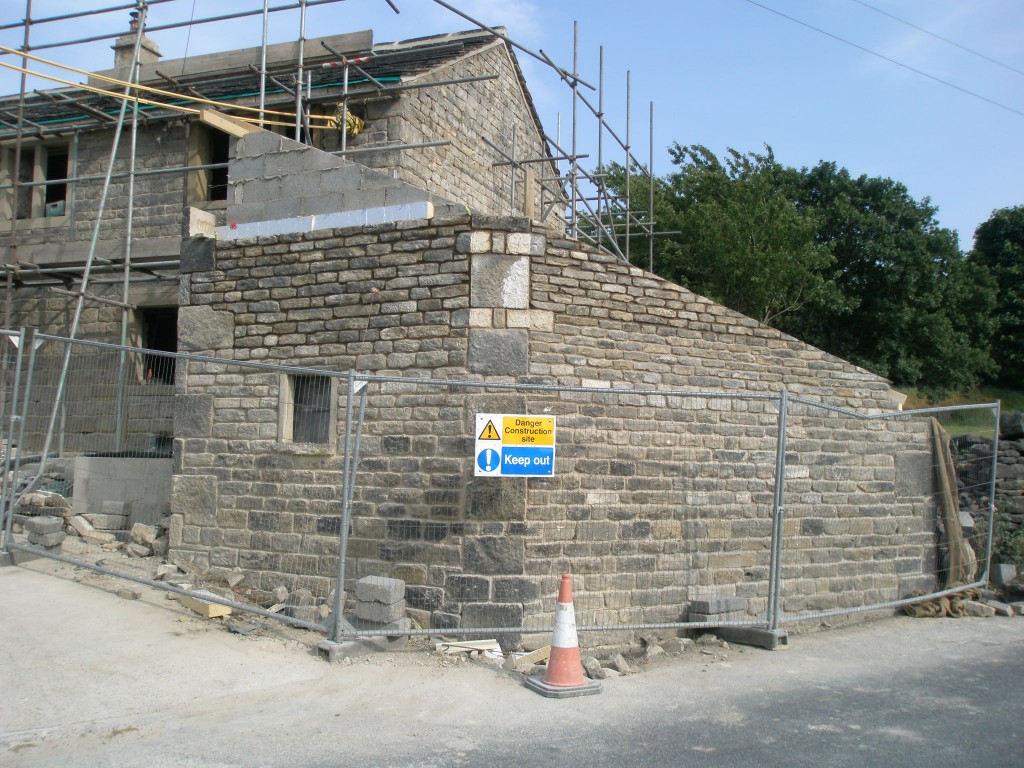 The roadside wall is now up to the right height.