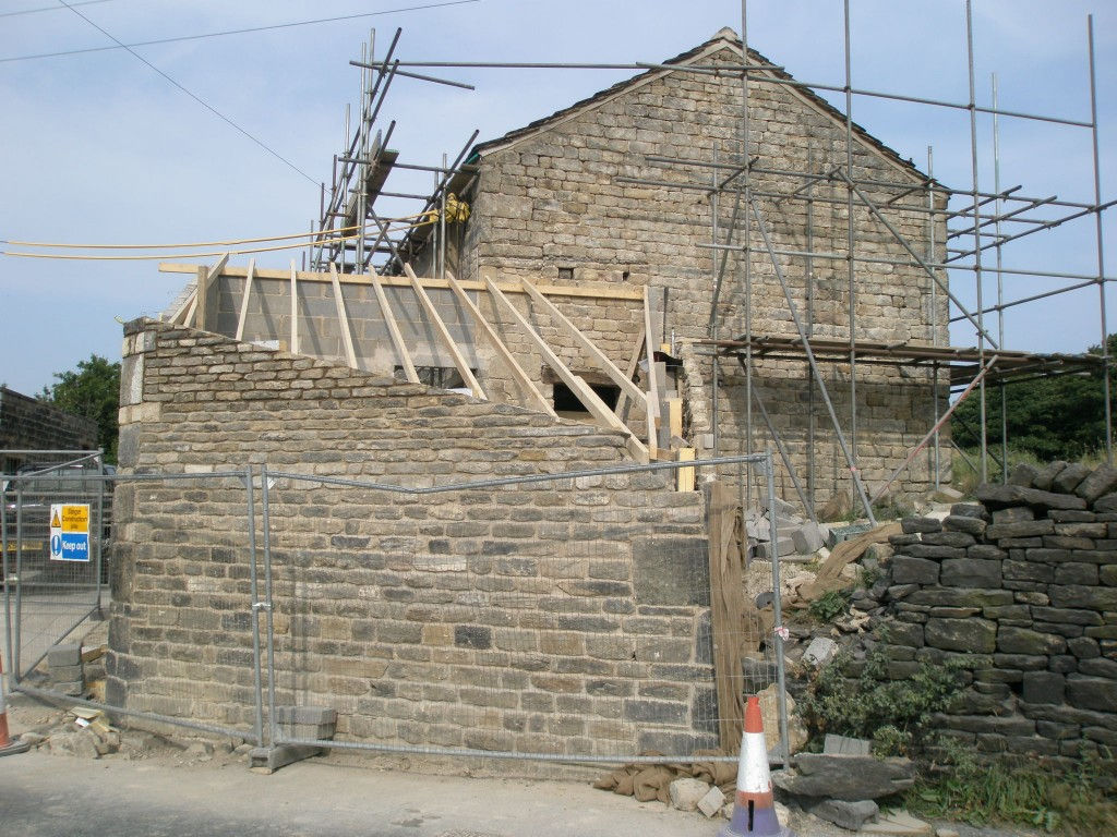 The roadside wall is now full height and the rafters have been installed.