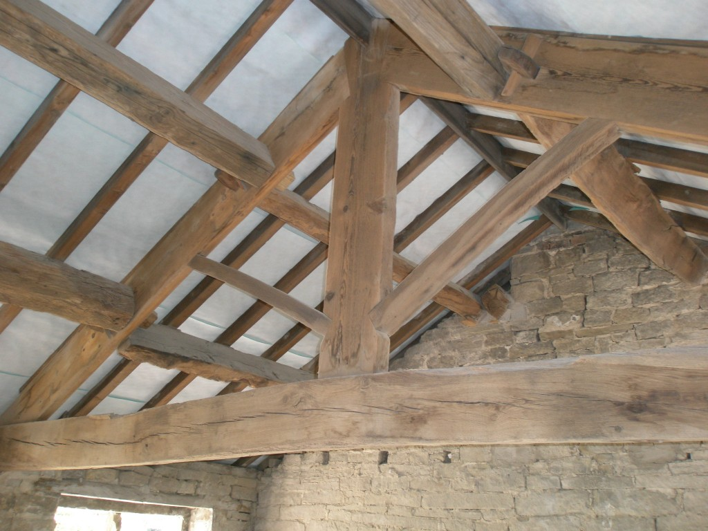Inside number 9.  You can see the King post truss and the tenon joints (with pegs) that join the purlins to the principal rafters.