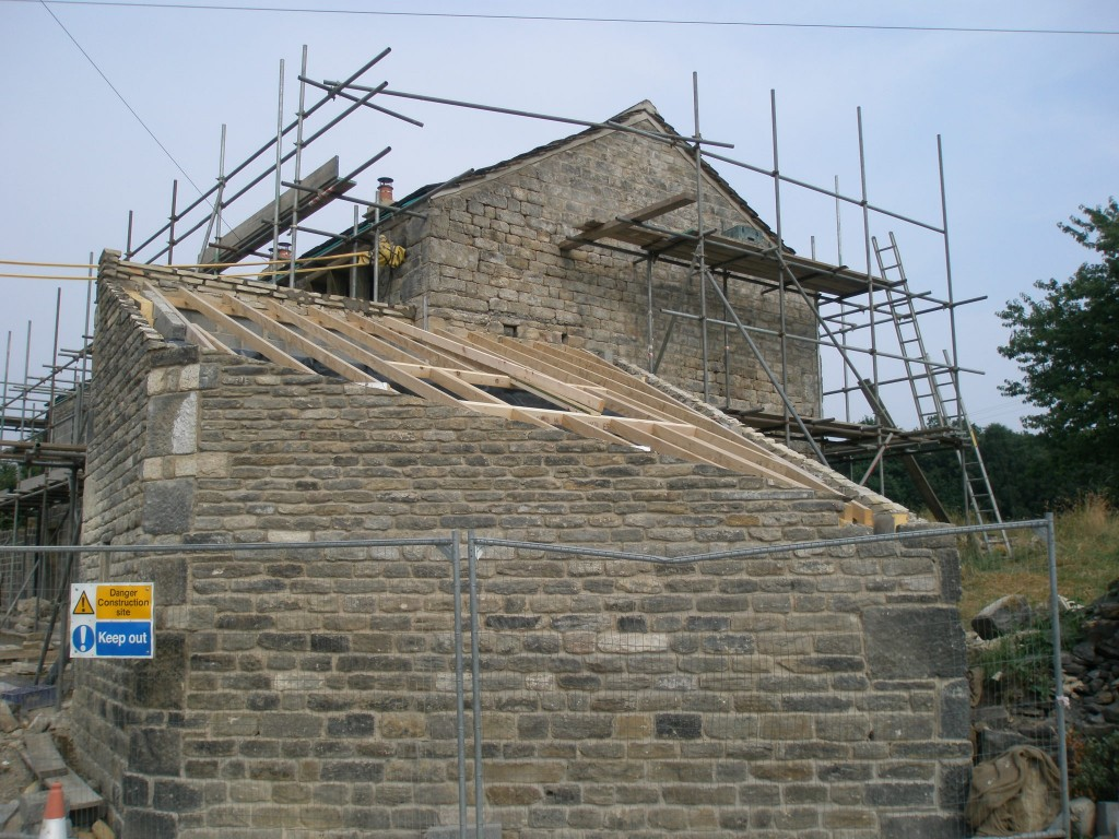 The weather has been cooler today, so we have been able to make a start on repointing the gable end of the main building (in the background).
