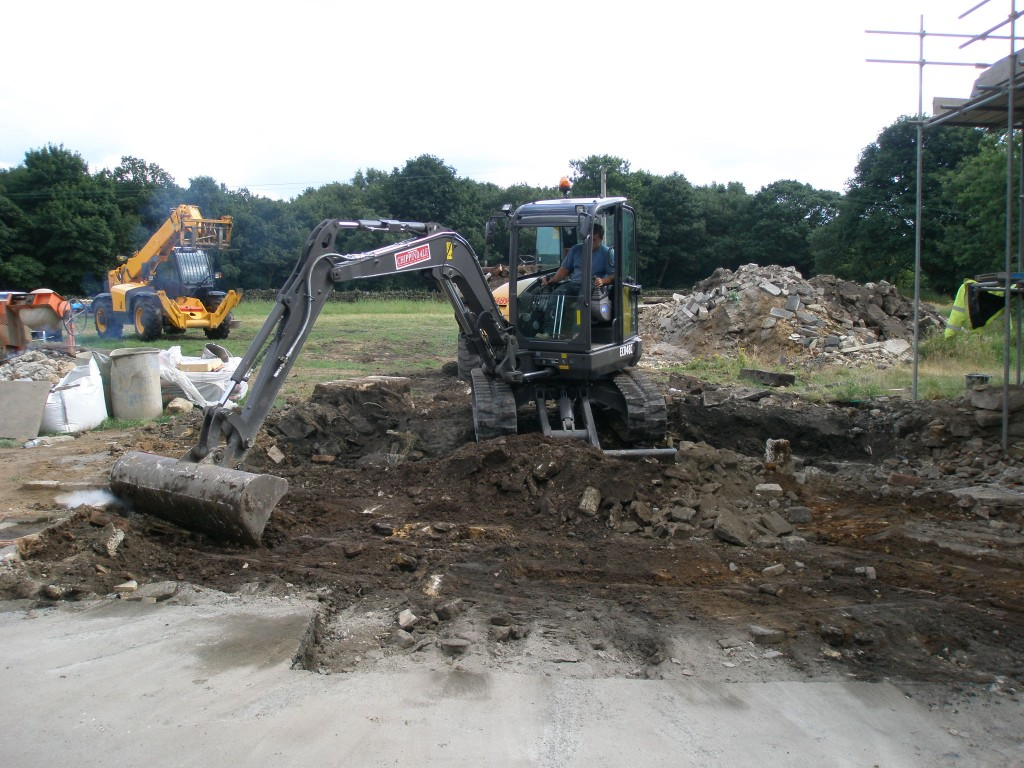 Matt at work with a 4.5 tonne digger. The spoil heap (in the background) gets bigger and bigger.