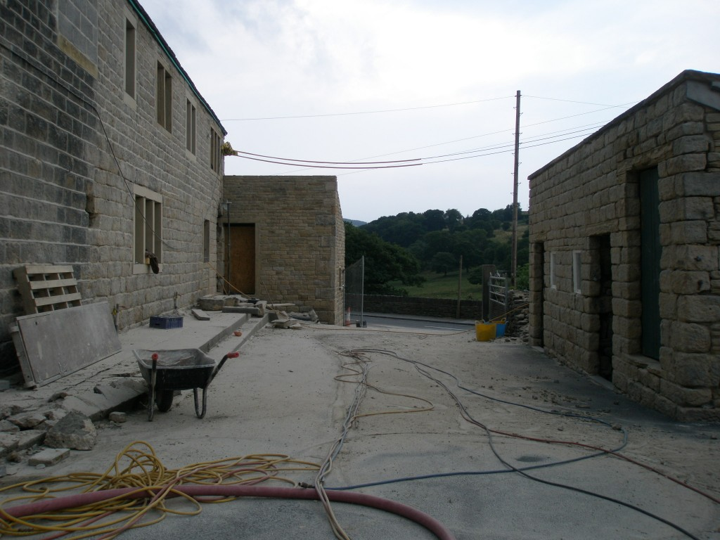 "The newly rebuilt extension and the outbuildings have been sandblasted to get them to ""fit together""."
