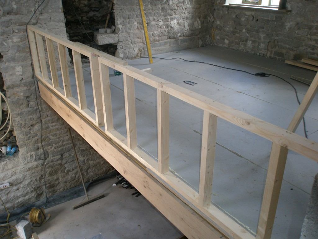 The view from the stairwell.  The gap in the middle of the parapet wall is to accomodate an oak post that will connect with the king post truss above.