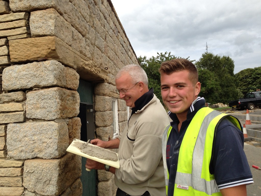Daniel (the apprentice) teaching me how to point using lime mortar.  This is time consuming.