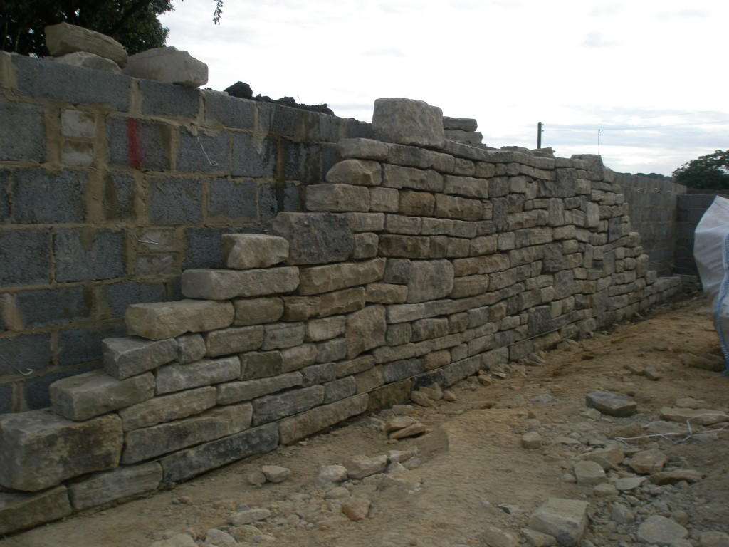 This is the reclaimed stone wall that has been built in front of the retaining wall in the courtyard garden.