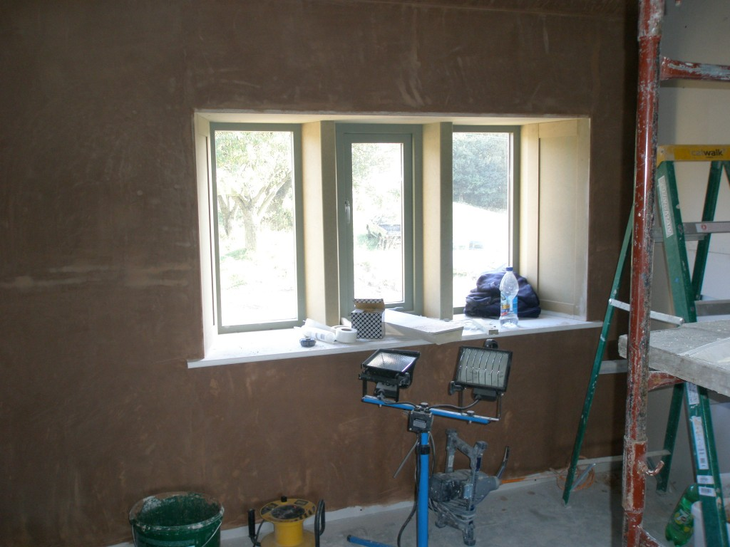We have always used this window as our prototype.  As soon as the plasterers are finished in here, we will paint up this window and get the architrave added.  We will also put up a strip of skirting board.