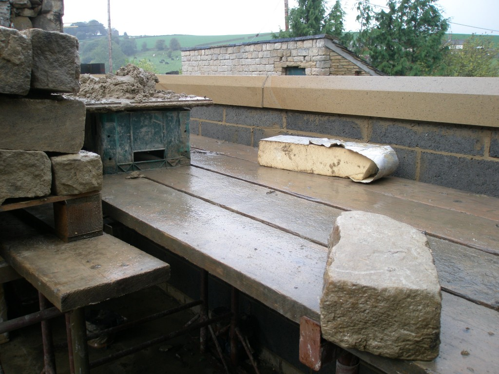 You can see here very clearly the ashlar string course that separates the upstand on the work surface from the reclaimed stone wall (yet to be built) above.