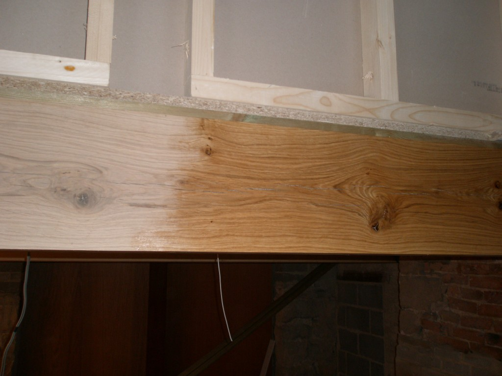 We have decided to paint the new green oak beams in the cottage.  This should help provide some protection from the plasterers! The unpainted section is on the left, the painted section the right. It has really brought the grain out of the wood.