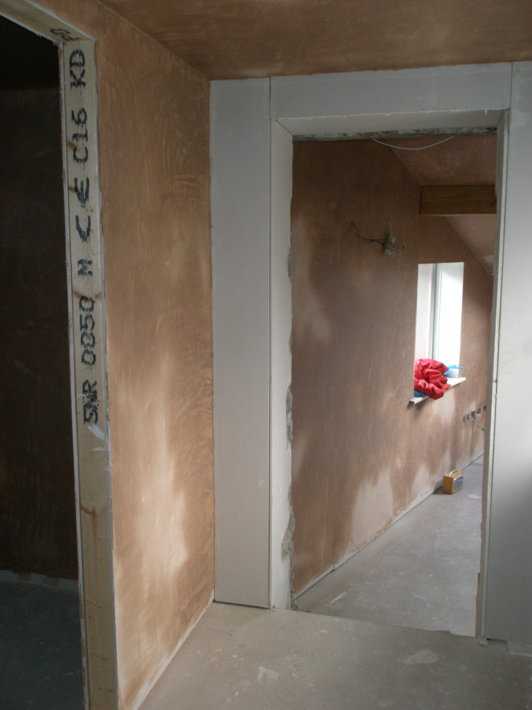 The door on the left is to a WC next to the study.  This has been completely plastered.