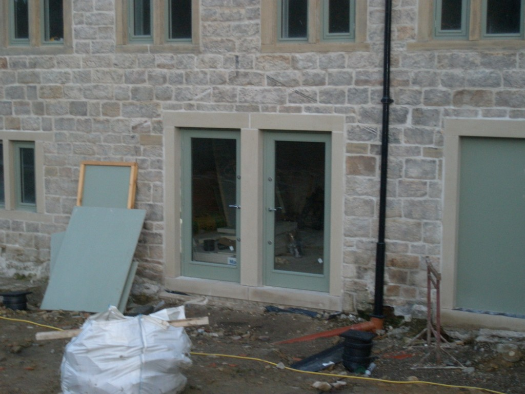 The new rear doors really do let a lot of light into the building.  The second pair of doors will be installed on Friday.