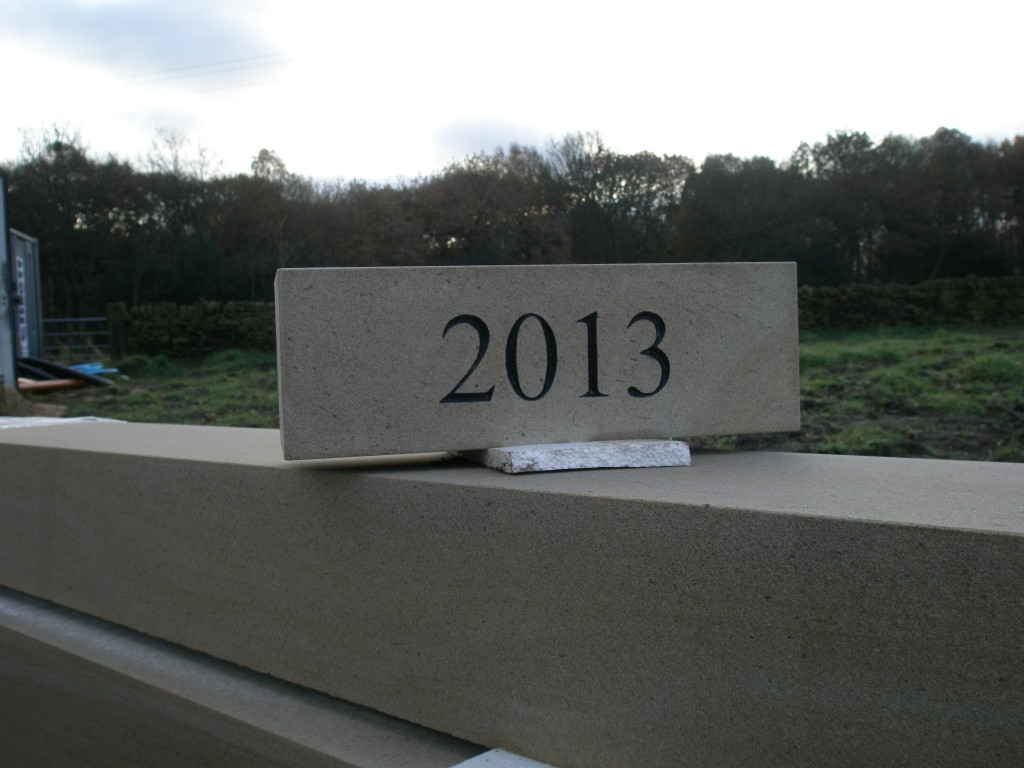 The date stone was made at the same quarry as we acquire all of the ashlar for the extension.