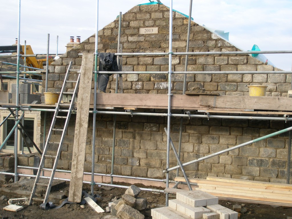 We have put the date stone on the end gable on the back of the extension.  There is a date stone from 1861 on another part of the building.  This isn't when it was originally built, but when some major renovation work was done.