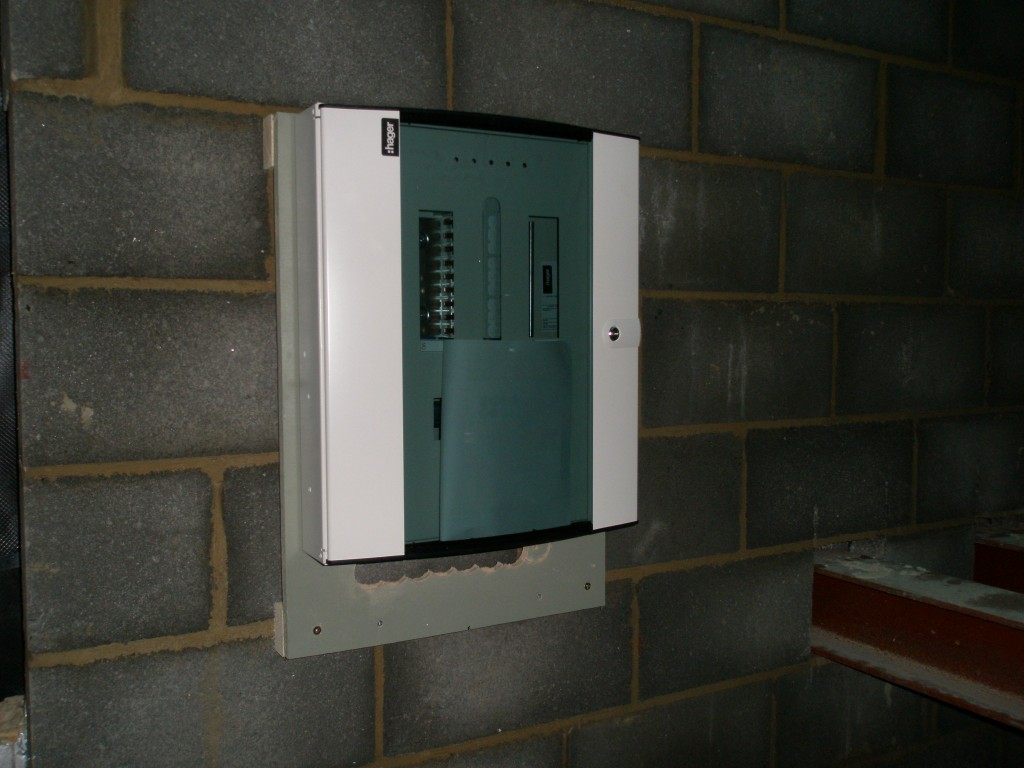 The new supply comes into a meter box on the opposite side of this wall.  A cable will then come through the wall and feed this consumer unit.  There is a feed from here to a second consumer unit in the renovated part of the property as well as a feed to the shed.