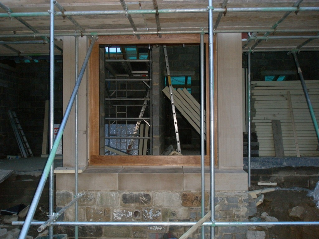 This oak frame weighs about 80kgs and will only go in via the large openings for the bi-folding doors.  It will be glazed on Monday.  The glass is onsite already, but weighs a further 150kgs.  Hence the frame and glass have been installed separately.