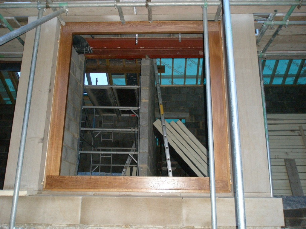 It is difficult to see clearly becuase the scaffolding is in the way, but this is a very large oak frame.  When Huddersfield Joinery brought it on site, it looked more like a piece of furniture than a window!
