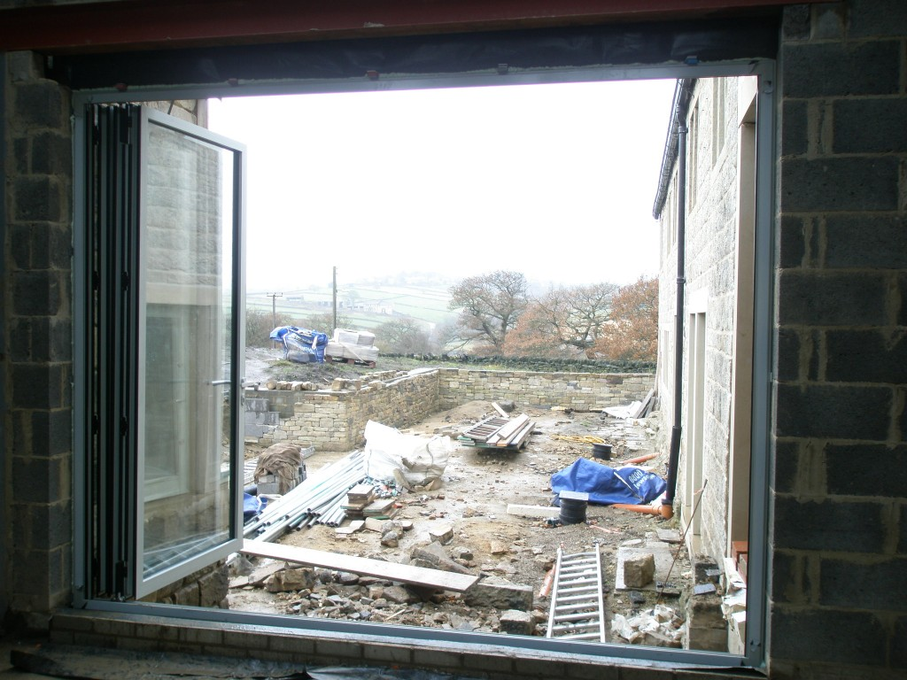 There will be a set of stone steps outside these doors that will take you into the sunken garden.  We are concentrating on getting the house finished first before working on the sunken garden.  At the moment, it is a bit of a mess.