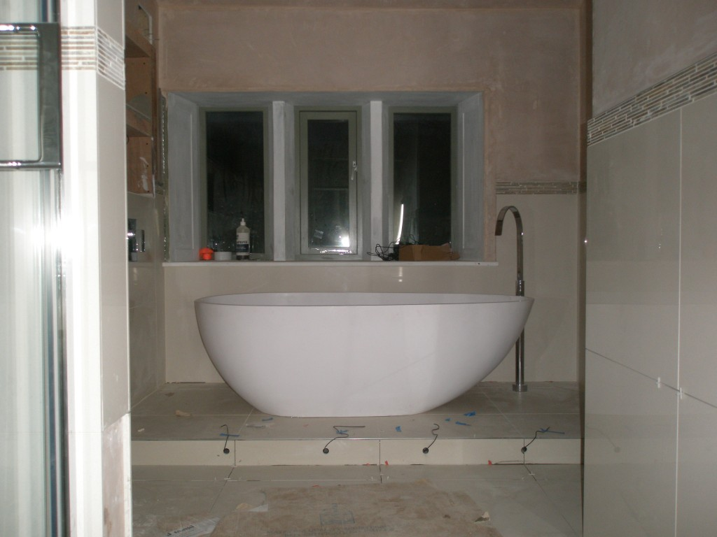 The bath is finally in place in the upstairs bathroom.  It weighs over 170kgs and it took 5 plumbers to get it up the stairs and into position.  I think there was a lot of relief all round once this was in position and still in one place.