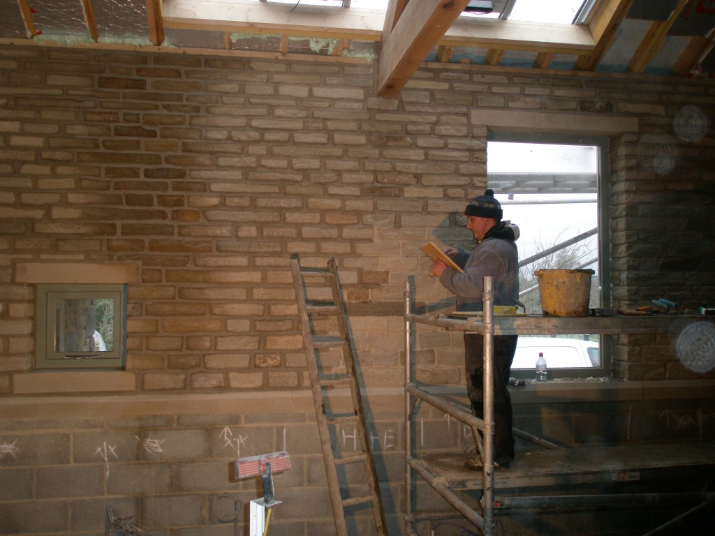 This internal wall has been built using stone from a couple of walls that we knocked down in the existing cottages.  We are using the same lime mortar that we are using to point the outside of the building.