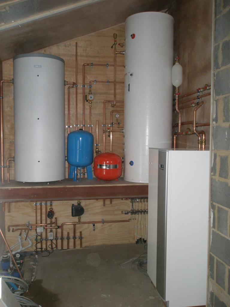 The ground source heat pump (the unit that looks like a fridge/freezer) is a Nibe 1145.  There is probably another day's worth of pipework still to go in.  These systems are complex and take up significant space - this is starting to look like a plant room!