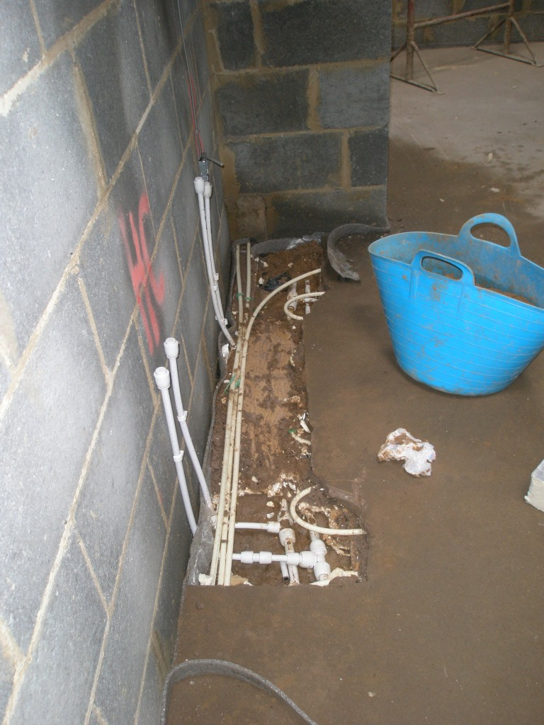 The floor in one of the sownstairs bathrooms did not dry out over the Christmas period despite the underfloor heathing being on.  We suspected that there might have been a leak in the underfloor pipework.  This week we have had to dig out the area of floor screed to find the leak.
