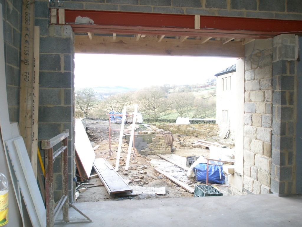 Here's the opening in the master bedroom before the bifolding doors are installed.  Ignore the fact that the back garden looks like a building site - the views are great.