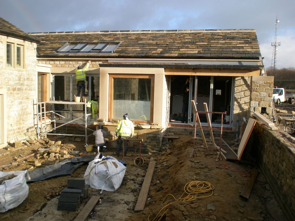 The builders are finishing off the pointing on this elevation of the extension while the frames for the bi-folding doors are being installed.