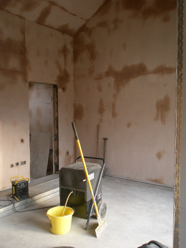 The plasterers have made good progress this week.  The two ensuites, dressing room and the master bedroom have been completely plastered.  With the ground source heat pump running, the plaster is drying out fairly quickly.  To accelerate the drying process we are using a dehumidifer.