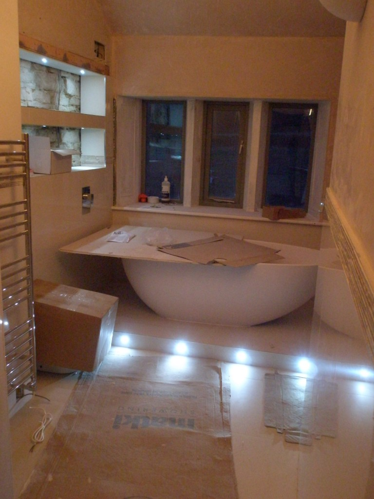 ignore the cardboard box over the toilet and the board over the bath.  This is the upstairs bathroom with the main lights and LEDs turned on.  The extractor fan is running.  This is controlled by the left button.