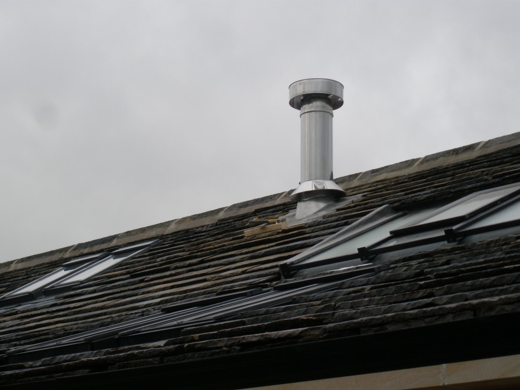 This is the rear elevation of the new extension and shows where the new flue appears through the roof.  This is a lead liner that covers where the chimney meets the roof.  The intention was that the flue would only ever be seen from the rear elevation.