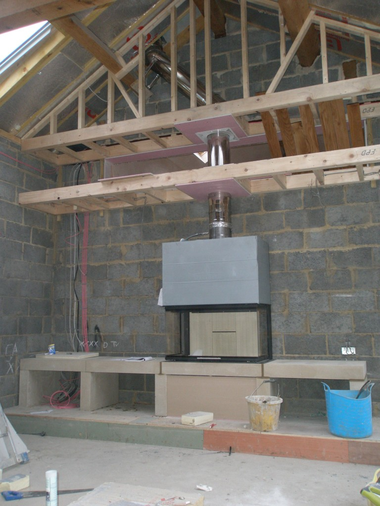 "We now have the ashlar stone work in place for the fire place.  There are three stone ""boxes"" under the fireplace.  Two will be for logs and the third (the one on the far left) has cabling for a TV/HiFi.  I am just not sure that if a TV/HiFi was placed here whether it would melt from the heat from the fireplace!"
