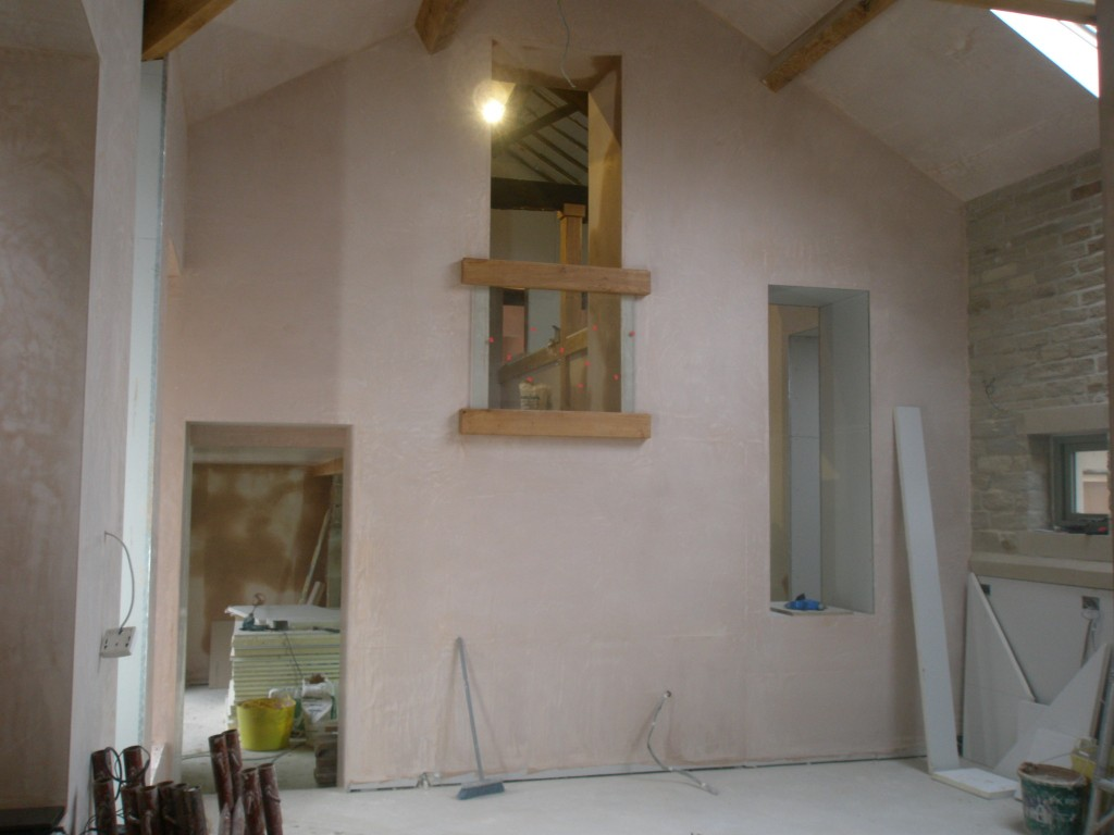 The balcony into the kitchen is from the upstairs study and marks the transition between old and new. The doorway on the left leads into the hall (where we are just finishing off the plastering).