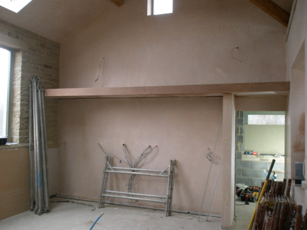 There is a series of tall unit to go into this space.  The canopy slightly overhangs the units as there are lights embedded in the canopy.  There is another light just over the doorway into the utility room.