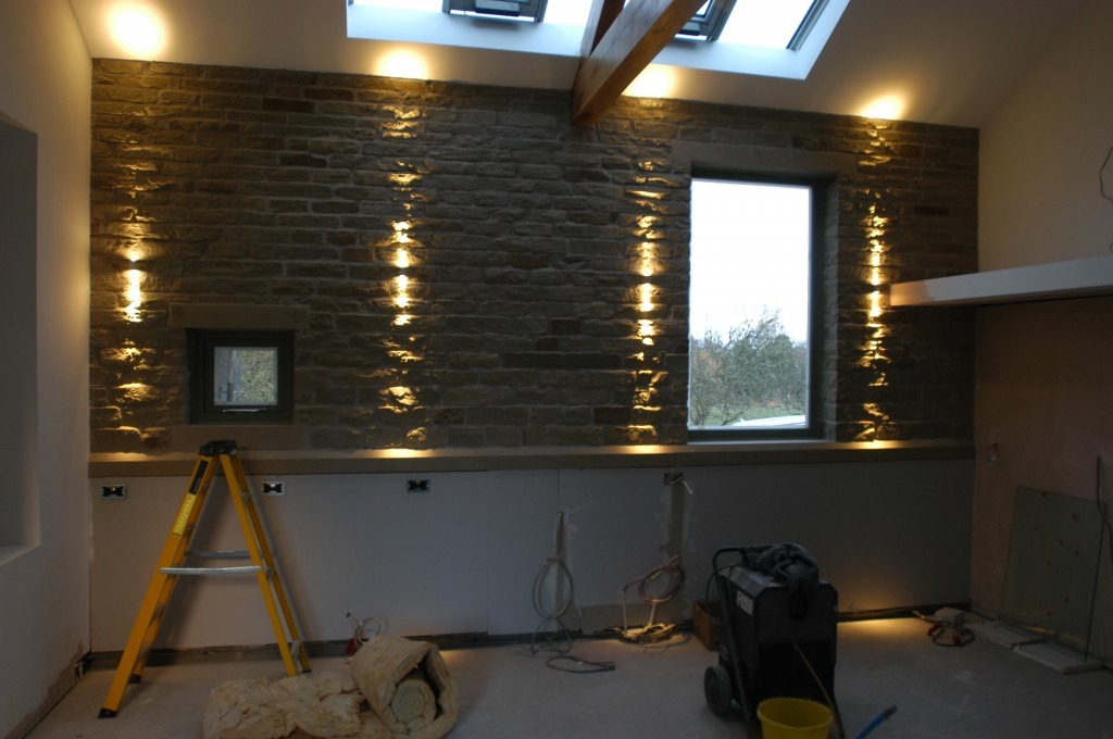 The light on the furthest left needs to be adjusted (look at the shape of the light on the ceiling), but these start to show off the texture of the reclaimed stone wall.