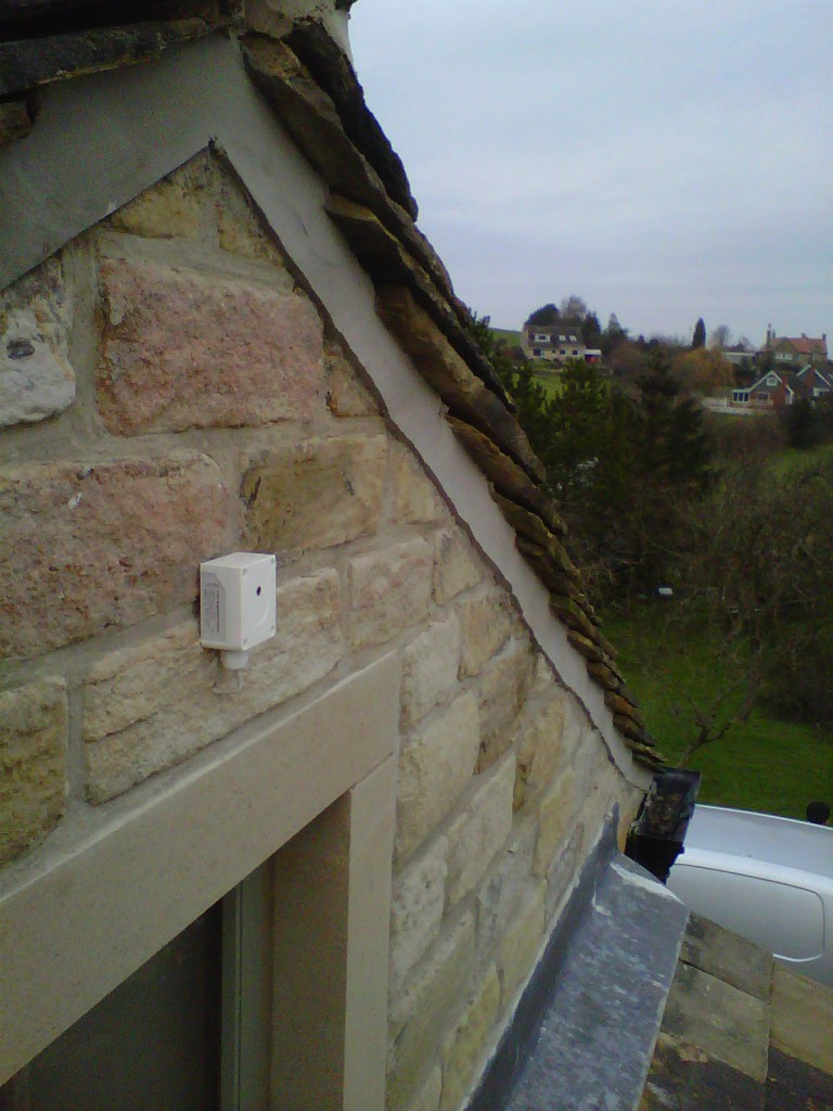The sensor is positioned high up on the small gable end in the extension.  This is away from any light from street lighting or from the security light at the front of the building.
