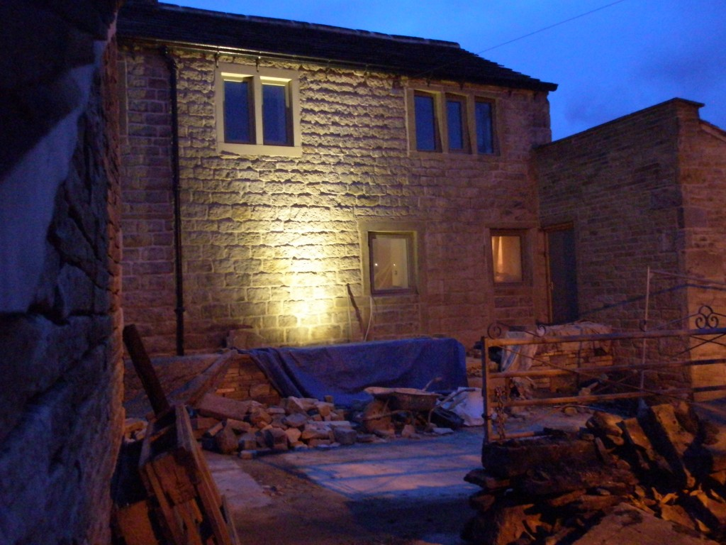 This shows the effect of one external light positioned about 50cms from the base of the way.  This is using a 5W LED lamp with a 45 degree spread.  We will position 5 lights along this wall to show up the texture of the stone.  We are using Robus uplighters.
